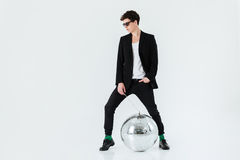 Full length portrait of man in suit with disco ball Royalty Free Stock Image