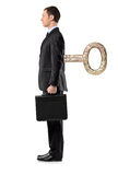 Full length portrait of a man with wind-up key Royalty Free Stock Photography