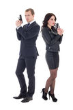 Full length portrait of man and woman special agents with guns i Royalty Free Stock Image