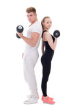 Full length portrait of man and woman in sportswear doing exerci Royalty Free Stock Image