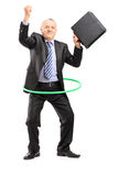 Full length portrait of a matue businessman dancing with a hula Royalty Free Stock Photo
