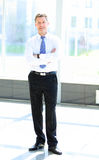 Full length portrait of a mature business man with hands Royalty Free Stock Photos