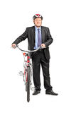Full length portrait of a mature businessperson holding a bicycl Royalty Free Stock Photo