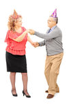 Full length portrait of mature couple dancing on a party Royalty Free Stock Image
