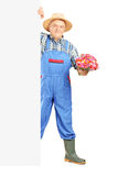 Full length portrait of a mature florist holding a bunch of flowers Stock Images