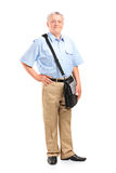 Full length portrait of a mature mailman Royalty Free Stock Image
