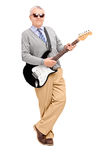 Full length portrait of a mature man with electric guitar leanin Stock Photography
