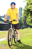 Full length portrait of a  mature man in sportswear on his bicyc Stock Photography