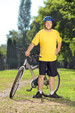 Full length portrait of a  mature man in sportswear next to his Royalty Free Stock Images