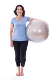 Full length portrait of mature woman with fitness ball isolated Stock Images