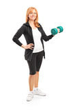 Full length portrait of a mature woman lifting up a dumbbell Stock Images