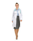 Full length portrait of medical doctor woman going Royalty Free Stock Photos