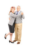 Full length portrait of a middle aged couple dancing Stock Image