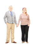 Full length portrait of a middle aged couple holding hands and p Stock Photography