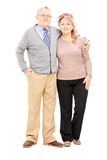 Full length portrait of a middle aged couple in a hug looking at Royalty Free Stock Photography