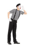 Full length portrait of a mime artist shouting. Isolated on white background Stock Images