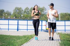 Active Young Couple Jogging royalty free stock photo