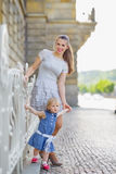 Full length portrait of mother and baby in city Royalty Free Stock Photo