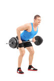 Full length portrait of a muscular bodybuilder lifting a weight Stock Photo