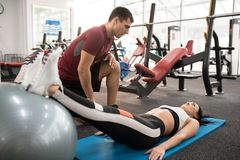Fitness Instructor Working with Young Woman stock photo