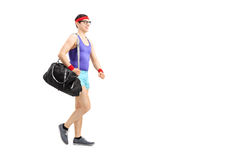 Full length portrait of a nerdy athlete waking Stock Photography