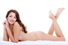 Full-length portrait of a nude flirting woman Stock Photography
