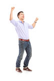Full length portrait of an overjoyed young man Stock Images