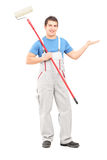 Full length portrait of a painter in a uniform with a brush Royalty Free Stock Photos