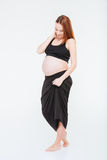 Full length portrait of a pregnant woman Stock Photos