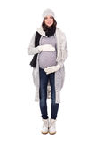 Full length portrait of pregnant woman in winter clothes isolate Royalty Free Stock Photography
