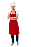 Full length portrait of pretty female chef Stock Photography