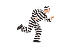 Full length portrait of a prisoner escaping. On white background stock photography