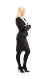 Full length portrait of a professional woman standing with arms Royalty Free Stock Photos