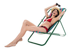 Full length portrait of relaxed cheerful bikini woman Royalty Free Stock Photos
