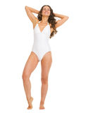 Full length portrait of relaxed woman in swimsuit Stock Photo