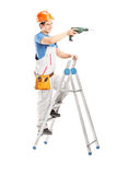 Full length portrait of a repairman with a drilling machine on a Stock Photos