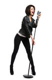 Full-length portrait of rock musician with microphone Stock Image