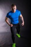 Full length Portrait of runner on start, ready to go. on a dark background Royalty Free Stock Photo