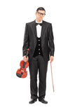 Full length portrait of a sad musician holding a violin Stock Photography