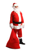 Full length portrait of a Santa Claus posing near a bag Royalty Free Stock Photo