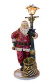 Full length portrait of a Santa Claus posing near a bag isolated on white background. Full length portrait of sculpture of a Santa Claus posing near a bag Stock Photo