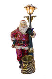 Full length portrait of a Santa Claus posing near a bag isolated on white background. Full length portrait of sculpture of a Santa Claus posing near a bag Stock Photography