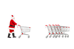 Full length portrait of a Santa Claus returning an empty shoppin Stock Image