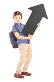 Full length portrait of a schoolboy with bag holding a big black Royalty Free Stock Images
