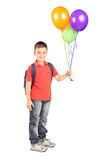 Full length portrait of a schoolboy with bag holding a bunch of Royalty Free Stock Photos