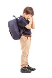 Full length portrait of a schoolboy crying Royalty Free Stock Images