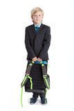 Full length portrait of schoolboy holding schoolbag in hands, looking at camera, isolated white background Stock Image