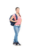Full length portrait of a schoolgirl with backpack Royalty Free Stock Images
