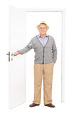 Full length portrait of a senior entering a room. Isolated on white background stock image