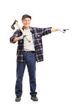 Full length portrait of a senior man holding an axe and pointing Royalty Free Stock Photo